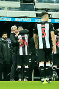 Newcastle United manager Steve Bruce congratulates Newcastle United goal scorer Miguel Almiron (#24) of Newcastle United following the Premier League match between Newcastle United and Crystal Palace at St. James's Park, Newcastle, England on 21 December 2019.