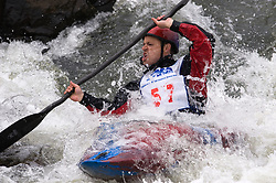 Pete Larson of Ballwin, Missouri races in the K1 men's long plastic class during the slalom course of the 42nd Annual Missouri Whitewater Championships. Larson placed second place in the class. The Missouri Whitewater Championships, held on the St. Francis River at the Millstream Gardens Conservation Area, is the oldest regional slalom race in the United States.