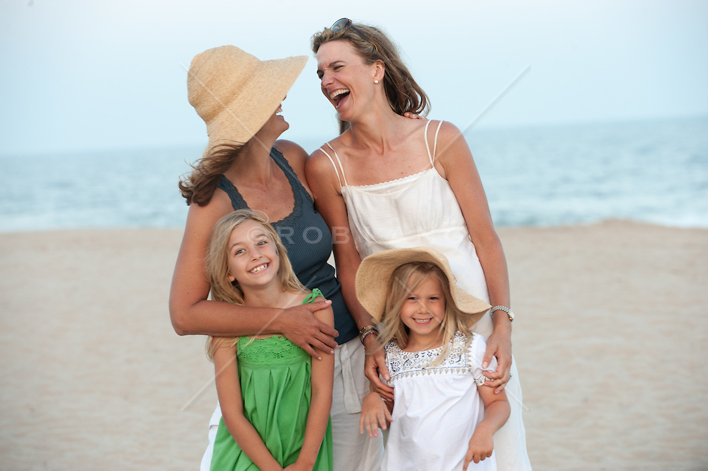 two women and two children enjoying time together at the beach in East Hampton, NY