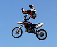 Jul 01, 2003; Anaheim, California, USA; Moto X star athlete RONNIE RENNER executing a tremendous stunt feet free with a full sized motobike at the opening of Disney's California Adventure &quot;X Games Experience&quot;.  Disney park has built two X-Arena's specifically for this 41 day event highlighting extreme sports for the launch of the 2003 ESPN X Games.<br />