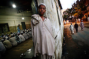 A Muslim boy is waiting for breakfast at a large Madrassa (Islamic school) in North-West Karachi, Pakistan's main economic hub.