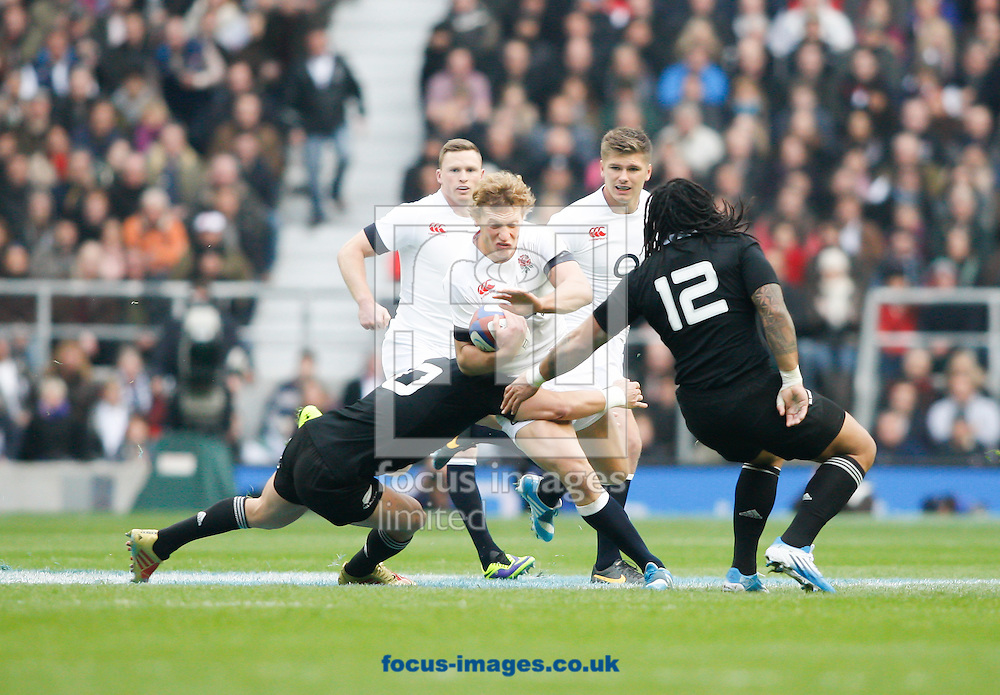 Picture by Andrew Tobin/Focus Images Ltd +44 7710 761829<br /> 16/11/2013<br /> Billy Twelvetrees is tackled by Dan Carter of New Zealand  during the QBE Internationals  match at Twickenham Stadium, Twickenham.