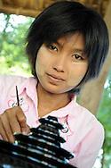 Burmese woman making traditional handicrafts