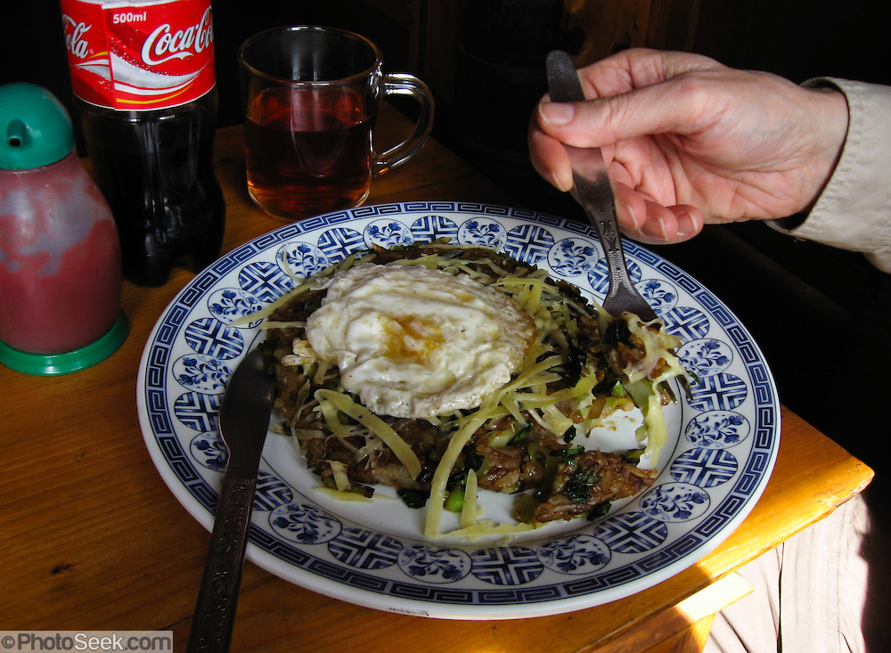 Swiss Rosti with egg and cheese. This food entree is commonly available in teahouses for trekkers in Nepal.