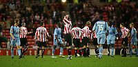 Fotball<br /> England 2004/2005<br /> Foto: SBI/Digitalsport<br /> NORWAY ONLY<br /> <br /> Sunderland v West Ham United<br /> Coca-Cola Championship, Stadium of Light, Sunderland 04/12/2004.<br /> <br /> Sunderland's Stephen Elliott (C) cannot believe it as his team-mate, Steven Caldwell, is shown the red card.