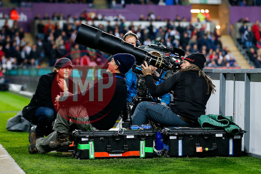 An American film crew shoot footage from the side of the pitch - Mandatory byline: Rogan Thomson/JMP - 07966 386802 - 19/10/2015 - FOOTBALL - Liberty Stadium - Swansea, Wales - Swansea City v Stoke City - Barclays Premier League.