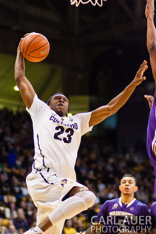 February 9th, 2014:  Colorado Buffaloes freshman guard Jaron Hopkins (23) attacks the basket for a thundering dunk in the second half of action in the NCAA Basketball game between the Washington Huskies and the University of Colorado Buffaloes at the Coors Events Center in Boulder, Colorado