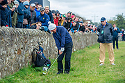 Gerry McIlroy, father of Rory McIlroy, plays his shot from near to the wall on the 16th green during the final round of the Alfred Dunhill Links Championship European Tour at St Andrews, West Sands, Scotland on 29 September 2019.