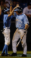 06/16/2006 University of North Carolina's Mike Cavasinni scores what would be the winning run against  cal State Fulerton  during, game 2 of the College World Series in Omaha Nebraska Friday evening. IT would be the second longest game in CWS history..(photo by Chris Machian  /Prairie Pixel Group)