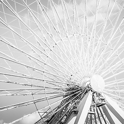 Panoramic Chicago Ferris Wheel black and white photo. The famous Navy Pier Ferris Wheel is a popular Chicago attraction . Panoramic ratio is 1:3. Image Copyright © Paul Velgos All Rights Reserved.