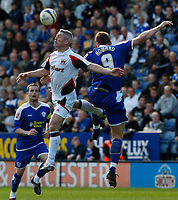Photo: Steve Bond/Richard Lane Photography. Leicester City v Carlisle United. Coca Cola League One. 04/04/2009. Graham Kavanagh (L) and Steve Howard (R) in the air