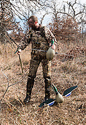 Vance Fielder sets up battery powered decoys while duck hunting at his family's private watershed lake in Shamrock, Oklahoma