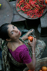 BANGLADESH DHAKA KAWRAN BAZAAR 2MARB05 - A fruit trader poses for a portrait at Kawran Bazaar vegetable market. The Bazaar has been in the Tejgaon area for at least 30 years and is one of the largest markets in Dhaka city...jre/Photo by Jiri Rezac..© Jiri Rezac 2005..Contact: +44 (0) 7050 110 417.Mobile:  +44 (0) 7801 337 683.Office:  +44 (0) 20 8968 9635..Email:   jiri@jirirezac.com.Web:    www.jirirezac.com..© All images Jiri Rezac 2005- All rights reserved.