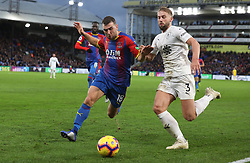 Crystal Palace James McArthur (left) and Burnley's Charlie Taylor battle for the ball
