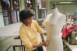 Woman designing clothes in factory in Havana; Cuba,