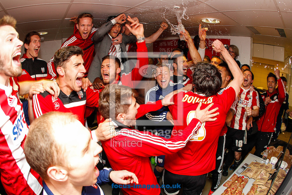 Brentford players celebrate promotion after the game against  Preston North End at Griffin Park, London<br /> Picture by Mark D Fuller/Focus Images Ltd +44 7774 216216<br /> 18/04/2014