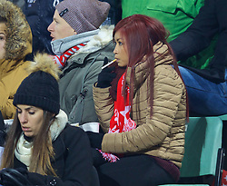 LIVERPOOL, ENGLAND - Thursday, December 10, 2015: A female supporter smokes during the UEFA Europa League Group Stage Group B match between Liverpool and FC Sion at Stade de Tourbillon. (Pic by David Rawcliffe/Propaganda)