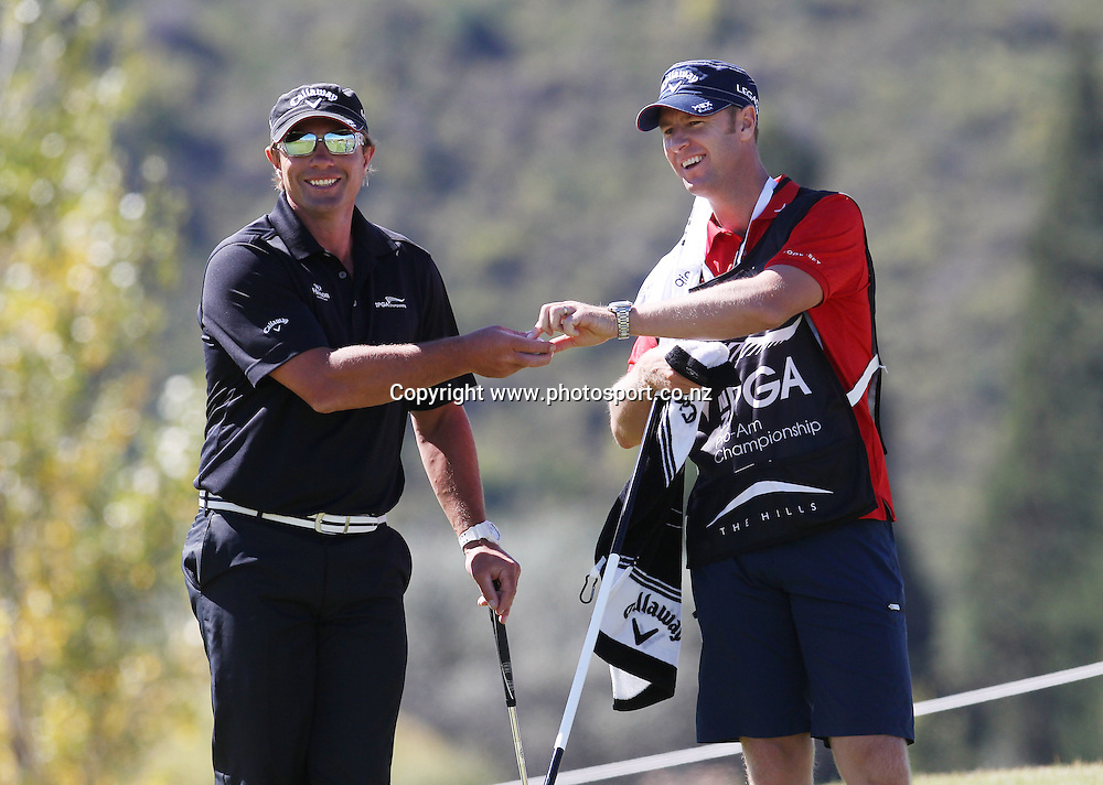 Brendan jones caddies for Justin Marshall during round four of the New Zealand PGA championships at The Hills, Arrowtown, New Zealand. Sunday, 3 March 2013. Photo: Michael Thomas/Photosport.co.nz