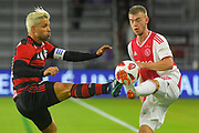 Ajax midefielder Daley Sinkgraven (8) and Flamengo midfielder Diego (10) go for a ball during a Florida Cup match at Orlando City Stadium on Jan. 10, 2019 in Orlando, Florida. <br /> <br /> ©2019 Scott A. Miller