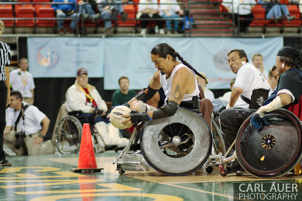 July 7th, 2006: Anchorage, AK - Arron Powlass reaches to score as he is checked from behind as White defeated Blue in the gold medal game of Quad Rugby at the 26th National Veterans Wheelchair Games.