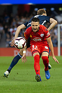 Adelaide United forward Apostolos Stamatelopoulos (33) is taken down at the Hyundai A-League Round 7 soccer match between Melbourne Victory v Adelaide United at Marvel Stadium in Melbourne, Australia.