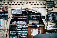 Various signs for lawyers and attorneys on the side of an old building, Kandy, Sri Lanka, Asia