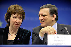 Catherine Ashton, Europe's new foreign minister left, listens as Jose Manuel Barroso, president of the European Commission, speaks during the press conference following the European Union Summit at the EU headquarters in Brussels, Belgium, on Thursday, Nov. 19, 2009. European leaders set divisions aside today as they chose their first-ever European Union president to represent the 27-nation bloc on the world stage. (Photo © Jock Fistick)