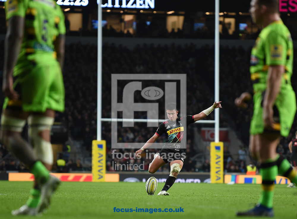 Marcus Smith of Harlequins kicks for goal whilst a dejected Dylan Hartley (c) of Northampton Saints looks on during the Aviva Premiership match at Twickenham Stadium, Twickenham<br /> Picture by Simon Dael/Focus Images Ltd 07866 555979<br /> 30/12/2017