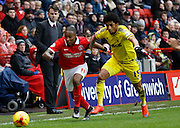 Nottingham Forest manager Dougie Freedman watches as Charlton Athletic midfielder Callum Harriott gets passed Nottingham Forest forward Ryan Mendes during the Sky Bet Championship match between Charlton Athletic and Nottingham Forest at The Valley, London, England on 2 January 2016. Photo by Andy Walter.