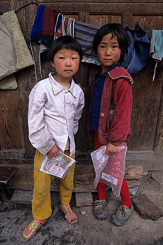 China, People, Tibetan farmers, Older Children. Sichuan, China.
