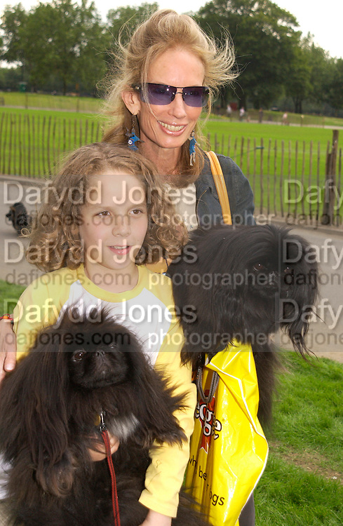 Julio Summers with Anne Summers, Fifi and Lulu, Macmillan dog day, in aid of Macmillan Cancer Relief, Chelsea , 6 July 2004. SUPPLIED FOR ONE-TIME USE ONLY-DO NOT ARCHIVE. © Copyright Photograph by Dafydd Jones 66 Stockwell Park Rd. London SW9 0DA Tel 020 7733 0108 www.dafjones.com