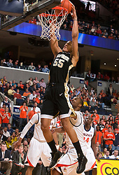 Wake Forest center Tony Woods (55) dunks against UVA.  The Virginia Cavaliers fell to the #13 ranked Wake Forest Demon Deacons 70-60 at the John Paul Jones Arena on the Grounds of the University of Virginia in Charlottesville, VA on February 28, 2009.