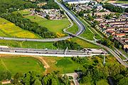 Nederland, Limburg, Roermond, 27-05-2013; Roertunnel in A73, noordelijk ingang in de bebouwde kom van Roermond. Wijk De Kemp.  De tunnel is aangelegd om natuur van het Roerdal te ontzien.<br /> Roer Tunnel in A73 constructed to protect the nature of the Roer valley next to residential districts in Roermond. <br /> luchtfoto (toeslag op standard tarieven)<br /> aerial photo (additional fee required)<br /> copyright foto/photo Siebe Swart