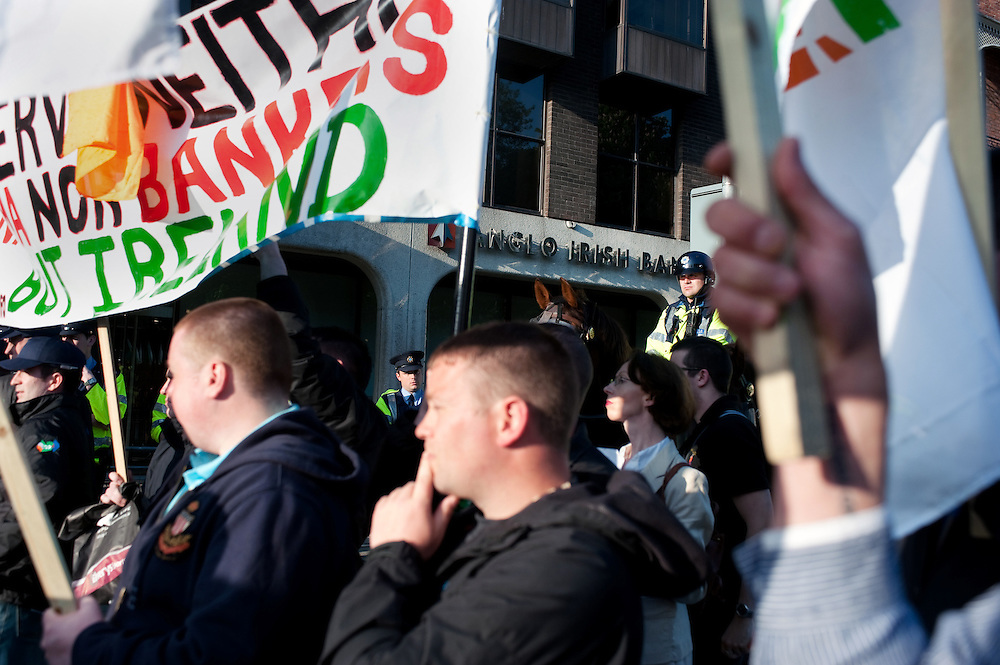 Protesters outside Anglo Irish Bank in Dublin against the economic situation in Ireland, particularly government cuts, bank bailouts and lack of jobs.
