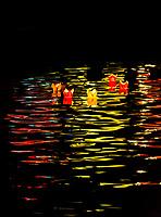 Paper lanterns floating on the Thu Bon River, Hoi An Full Moon Lantern Festival, Hoi An, Vietnam.