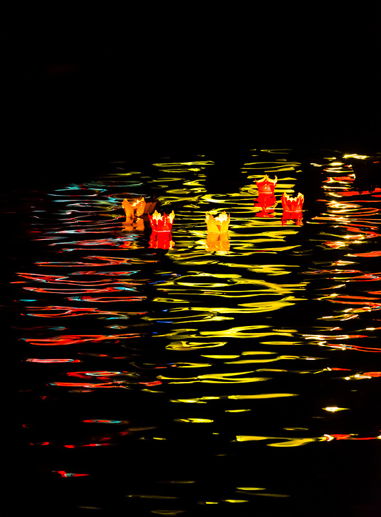 Paper lanterns floating on the Thu Bon River, Hoi An Full Moon Lantern Festival, Hoi An, Vietnam.