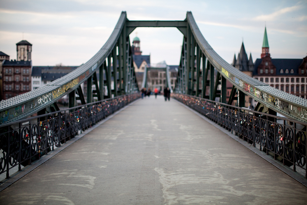 """Germany banned gatherings of more than 2 people called """"social distancing"""" because of the coronavirus. The empty """"Eiserner Steg"""" (English:Iron footbridge) usually very busy is a footbridge spanning the river Main in the city of Frankfurt, Germany."""