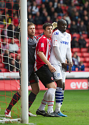 SHEFFIELD, ENGLAND - Saturday, March 17, 2012: Tranmere Rovers' Enoch Showunmi and Sheffield United's Harry Maguire during the Football League One match at Bramall Lane. (Pic by David Rawcliffe/Propaganda)