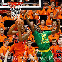 Oregon State's Langston Morris-Walker, left, grabs a rebound in front of  Oregon's Chris Boucher in the second half of an NCAA college basketball game, in Corvallis, Ore., on Sunday, Jan. 3, 2016. Oregon State won 70-57. (AP Photo/Timothy J. Gonzalez)