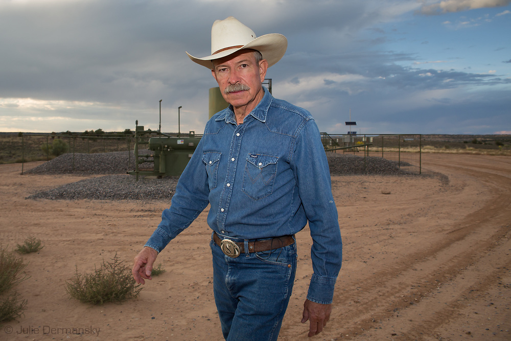 Don Schreiber on his ranch in Blanco, New Mexico. He is standing infront of one of the wells recently redrilled on BLM land that he leases. <br /> The Schreiber's own over 400 acres and lease hundreds more from the BLM. They do not own their mineral rights so they are have to contend with the drilling on their land. They successfully took on industry and the BLM, persuading them to twin existing drill sites instead of drilling hundreds of new ones.