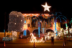 09 December, 05. New Orleans, Louisiana. Hurricane Katrina aftermath. <br /> Post hurricane Katrina light after the storm. Al Copeland, controversial wealthy local businessman and owner of several 'Copeland's' restaurants in the city puts on his famous light display at his house to the west of the city. Copeland insisted on having the show to help cheer the childen of the city, many of whom will have come to the display for years.<br /> Photo; ©Charlie Varley/varleypix.com