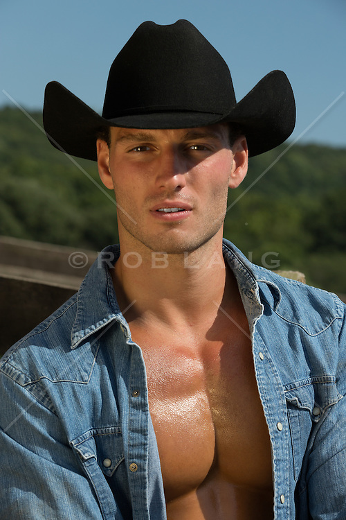 All American sexy cowboy with an open shirt on a ranch