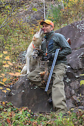A successful upland hunter takes a break with his Labrador retriever.