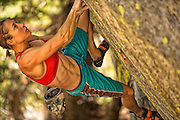 "Professional climber Lisa Rands bouldering at the ""Way Lake"" boulders near Mammoth Lakes California."