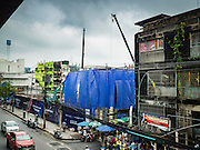 21 SEPTEMBER 2016 - BANGKOK, THAILAND: A construction site now occupies the land that used to be the Bang Chak Market. The market closed permanently on January 4, 2016. The Bang Chak Market served the community around Sois 91-97 on Sukhumvit Road in the Bangkok suburbs. Bangkok city authorities put up notices in late November 2015 that the market would be closed by January 1, 2016 and redevelopment would start shortly after that. Market vendors said condominiums are being built on the land.      PHOTO BY JACK KURTZ