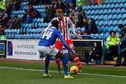 Stevenage FC Defender Connor Ogilvie takes on Carlisle United Defender Alexander McQueen during the Sky Bet League 2 match between Carlisle United and Stevenage at Brunton Park, Carlisle, England on 20 February 2016. Photo by Craig McAllister.