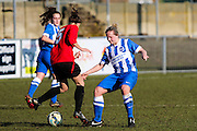 Brighton's Jay Blackie tackles Claire Stevens during the FA Women's Sussex Challenge Cup semi-final match between Brighton Ladies and Hassocks Ladies FC at Culver Road, Lancing, United Kingdom on 15 February 2015. Photo by Geoff Penn.