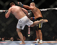 "LONDON, ENGLAND, JUNE 7, 2008: Antoni Hardonk (left) thows a kick to the leg of Eddie Sanchez during ""UFC 85: Bedlam"" inside the O2 Arena in Greenwich, London on June 7, 2008."
