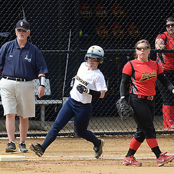 Staff photos by Tom Kelly IV<br /> Neumann's Allie White (5) gets hits a single through the infield during her first at bat against Gwynedd Mercy, making her the all time hit leader for Neumann.