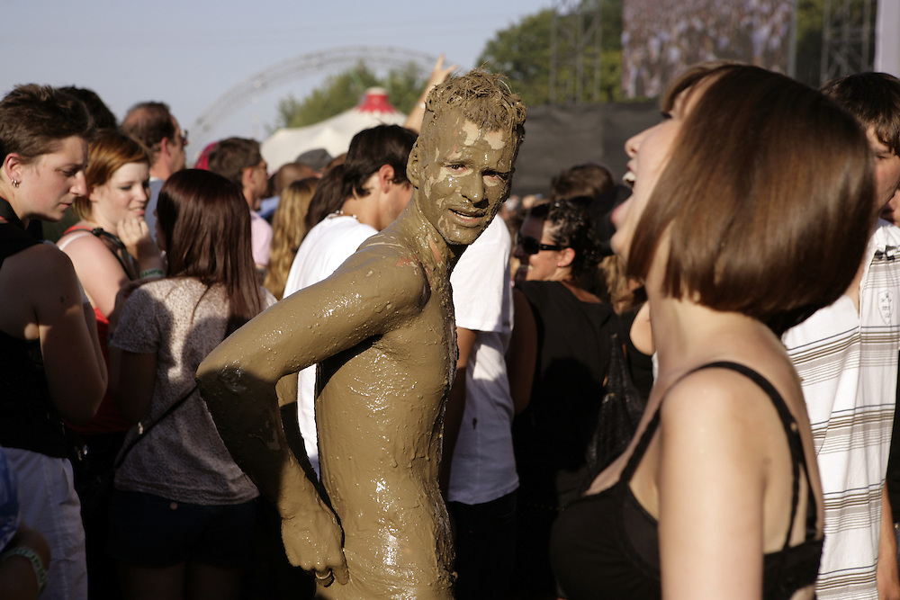 Festival goer covered in mud,  34th Paleo Festival, Nyon, Switzerland.